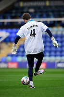 Blackpool's Chris Maxwell during the pre-match warm-up wearing a t-shirt in tribute to Warren Green, Blackpool's academy manager, who died aged 46<br /> <br /> Photographer Chris Vaughan/CameraSport<br /> <br /> The EFL Sky Bet League One - Peterborough United v Blackpool - Saturday 21st November 2020 - London Road Stadium - Peterborough<br /> <br /> World Copyright © 2020 CameraSport. All rights reserved. 43 Linden Ave. Countesthorpe. Leicester. England. LE8 5PG - Tel: +44 (0) 116 277 4147 - admin@camerasport.com - www.camerasport.com