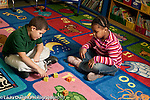Education Elementary school Grade 1 mathematics hands on learning boy and girl counting dots on foam dice and adding horizontal