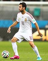 Cesc Fabregas of Spain wearing his odd coloured Puma 'evoPOWER tricks' boots