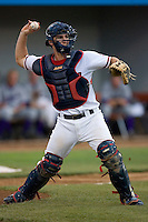 Catcher Sean Rooney #5 of the Potomac Nationals makes a throw to first base at Pfitzner Stadium June 11, 2009 in Woodbridge, Virginia. (Photo by Brian Westerholt / Four Seam Images)