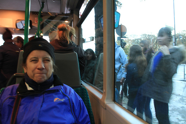 Beth taking a bus ride from the  Avenue des Champs Elysees to the Royal Phare Hotel, Paris, France.