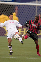 New England Revolution's Brian Kamler and the MetroStars' Fabian Taylor both go for the ball. The New England Revolution played the NY/NJ MetroStars to a 1 to 1 tie at Giant's Stadium, East Rutherford, NJ, on April 25, 2004.