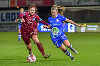 Lorene Martin (4) of KRC Genk and Lyndsey Van Belle (14) of AA Gentpictured during a female soccer game between  AA Gent Ladies and Racing Genk on the 12 th matchday of the 2020 - 2021 season of Belgian Scooore Womens Super League , friday 29 th of January 2021  in Oostakker , Belgium . PHOTO SPORTPIX.BE | SPP | DIRK VUYLSTEKE