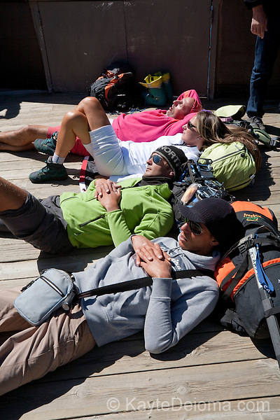 Mountain Climbers taking a break after coming off of Mont-Blanc at Aiguille du Midi, Chamonix-Mont-Blanc, France
