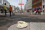 "Folkestone Triennial public art exhibition. Kent UK 2008. Tracey Emin ""Baby Things"". Baby cap hat on bench Sandgate Road pedestrian precinct."