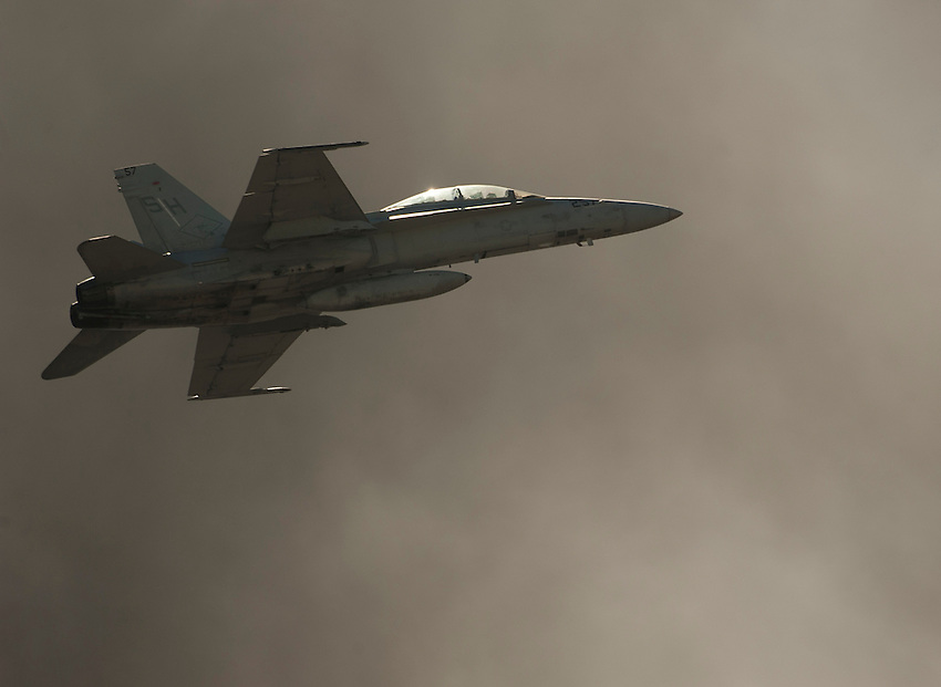 """121014-N-DR144-380 SAN DIEGO (October 14, 2012)- A Marine Corps F/A-18D Hornet assigned to Marine Fighter Attack Training Squadron (VMFAT) 101 flies through smoke from pyrotechnics during the Marine Corps Air Station Miramar 2012 Air Show. The air show, held October 12-14, was themed """"Marines In Flight: Celebrating 50 Years of Space Exploration."""" (U.S. Navy photo by Mass Communication Specialist 1st Class James R. Evans / RELEASED)"""