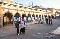 Essaouira, Morocco.  Girls on their Way to School cross Avenue Mohamed Zerktouni in the Medina.