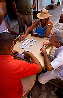 Men playing dominos on the street of old colonial village of Trinidad Cuba