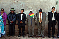 People line up to watch Bolivian Navy soldiers march to mourn the day they lost their ocean to Chile in the War of the Pacific. Bolivia lost what is now northern Chile in a war over nitrates leaving Bolivia without access to the ocean.