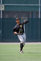 Pittsburgh Pirates Calvin Mitchell (15) throws back to the infield during an Instructional League intrasquad black and gold game on October 3, 2017 at Pirate City in Bradenton, Florida.  (Mike Janes/Four Seam Images)
