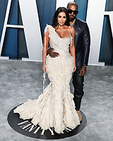 BEVERLY HILLS, LOS ANGELES, CALIFORNIA, USA - FEBRUARY 09: Kim Kardashian West and Kanye West arrive at the 2020 Vanity Fair Oscar Party held at the Wallis Annenberg Center for the Performing Arts on February 9, 2020 in Beverly Hills, Los Angeles, California, United States. (Photo by Xavier Collin/PictureGroup)