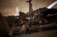 A Vietnamese soldier in uniform walks past a monument made from pieces of destroyed American aircraft which were shot down and other war trophies from the Vietnam War at the Vietnamese People's Army Museum in Hanoi, Vietnam on 17 November 2009.