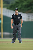 Base umpire Ben Sonntag during the South Atlantic League game between the West Virginia Power and the Kannapolis Intimidators at Intimidators Stadium on July 3, 2015 in Kannapolis, North Carolina.  The Intimidators defeated the Power 3-0 in a game called in the bottom of the 7th inning due to rain.  (Brian Westerholt/Four Seam Images)