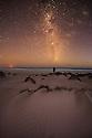 Man looking up at the milky Way at Sleaford Bay. Eyre Peninsula. South Australia.