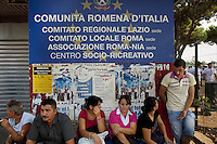 """Italy. Lazio region. Rome. Anagnina park with a sign """" Communita romena d'Italia"""". On sunday afternoon, the romanian men and women, all immigrants, meet there and spend time together. Romanian immigration. Anagnina is the south-eastern terminus of Line A of the Rome Metro. It is located at the junction of the Via Tuscolana and the Via Anagnina, close to the depot of Osteria del Curato. 25.09.2011 © 2011 Didier Ruef"""
