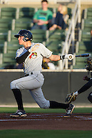JaCoby Jones (10) of the West Virginia Power follows through on his swing against the Kannapolis Intimidators at CMC-Northeast Stadium on April 17, 2014 in Kannapolis, North Carolina.  The Power defeated the Intimidators 4-3.  (Brian Westerholt/Four Seam Images)