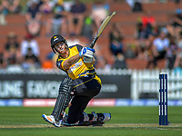 Michael Pollard hits a six during the Dream11 Super Smash cricket match between the Wellington Firebirds and Otago Volts at Basin Reserve in Wellington, New Zealand on Saturday, 21 December 2019. Photo: Dave Lintott / lintottphoto.co.nz