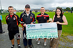 Marie Morris receives her cheque on Saturday after winning the lotto in the St Brendans Park FC club. L to r: Mike McCannon, Christy Leahy, Ed O'Regan and Marie Morris.