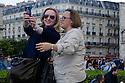 Paris, France. 09.05.2015. Women taking a selfie, Notre Dame, Paris, France.Photograph © Jane Hobson
