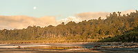 Sunset views on Southern Alps with Aoraki Mount Cook from wild beach of South Westland, Westland Tai Poutini National Park, UNESCO World Heritage Area, West Coast, New Zealand, NZ