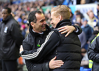Pictured L-R: Everton manager Roberto Martinez greets former team mate Swansea manager Garry Monk. Saturday 22 March 2014<br /> Re: Barclay's Premier League, Everton v Swansea City FC at Goodison Park, Liverpool, UK.
