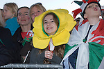 Welsh rugby fans watching the Welsh rugby team celebrate winning the Grand Slam in the Six Nations rugby tournament at The Senydd in Cardiff Bay..