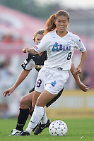 Homare Sawa of the Beat is trailed by Kristy Whelchel of the Power. The Atlanta Beat and the NY Power played to a 1-1 tie on 7/26/03 at Mitchel Athletic Complex, Uniondale, NY..