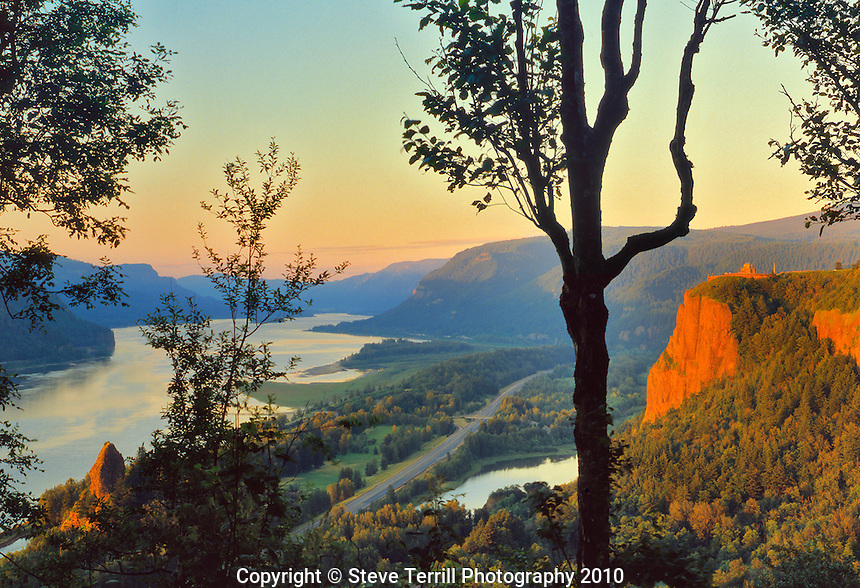 Vista House on Crown Point with Rooster Rock in Columbia River Gorge National Scenic Area, Oregon