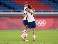 YOKOHAMA, JAPAN - JULY 30: Lynn Williams #21 of the USWNT celebrates her goal with Tobin Heath #7 during a game between Netherlands and USWNT at International Stadium Yokohama on July 30, 2021 in Yokohama, Japan.