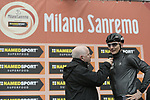 Andre Greipel (GER) Lotto-Soudal talks with Anthony McCrossan at sign on before the start of the 109th edition of Milan-Sanremo 2018 running 294km from Milan to Sanremo, Italy. 17th March 2018.<br /> Picture: LaPresse/Spada | Cyclefile<br /> <br /> <br /> All photos usage must carry mandatory copyright credit (© Cyclefile | LaPresse/Spada)