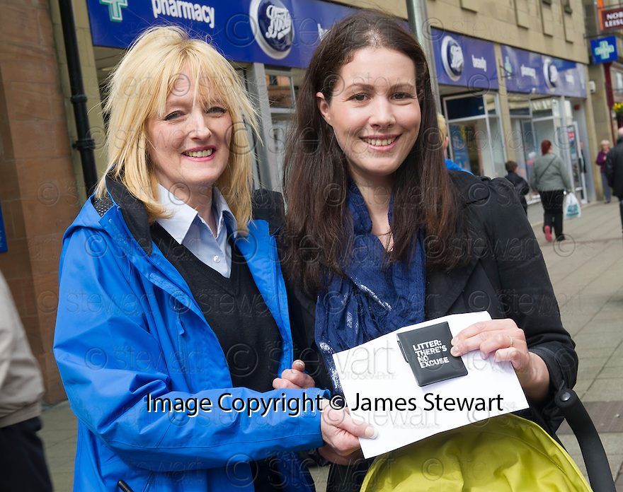 The Litter Strategy team £80 Litter Fine Information Day.... Rolanda Brown (right) receives her spot prize for using a High Street Litter Bin to dispose of her litter.