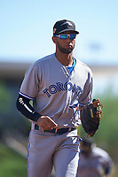 Peoria Javelinas shortstop Lourdes Gurriel (21), of the Toronto Blue Jays organization, jogs off the field between innings of an Arizona Fall League game against the Salt River Rafters on October 16, 2017 at Salt River Fields at Talking Stick in Scottsdale, Arizona.  Peoria defeated Salt River 6-2.  (Zachary Lucy/Four Seam Images)