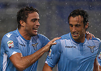Calcio, Serie A: Lazio vs Udinese. Roma, stadio Olimpico, 13 settembre 2015.<br /> Lazio's Alessandro Matri, left, celebrates with teammate Stefano Mauri after scoring during the Italian Serie A football match between Lazio and Udinese at Rome's Olympic stadium, 13 September 2015.<br /> UPDATE IMAGES PRESS/Isabella Bonotto