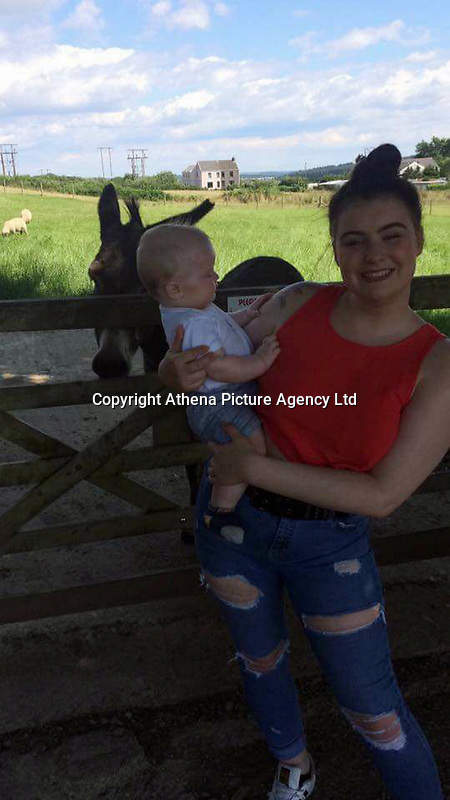 Pictured: Naomi Carter with baby Brogan, taken from open social media account.<br /> Re: Jason Thomas and girlfriend Naomi Carter have died and a baby has been taken to hospital after the car they were travelling in crashed into a lamp-post in the Swansea Valley, Wales, UK.<br /> South Wales Police was called to Swansea Road, Trebanos, in the county of Neath Port Talbot at about 3:15am of Saturday.<br /> The 23-year-old male driver and a female passenger, 18, were killed. 11-month-old baby Brogan was taken to hospital with non life-threatening injuries.<br /> Police have appealed for witnesses.