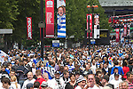 Reading 2 Swansea City 4, 30/05/2011. Wembley Stadium, Championship play-off final. Rival fans thronging Olympic Way on their way to the Npower Championship play-off final between Reading (blue) and Swansea City at Wembley Stadium. The match was won by Swansea by 4 goals to 2 watched by a crowd of 86,581. Swansea became the first Welsh team to reach the top division of English football since they themselves played there in 1983. Photo by Colin McPherson.