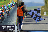 Match official Jorge Sandoval holds the chequered flag for the Under-23 and Senior Men's road race, Carterton-Martinborough-Gladstone circuit. Day three of the 2018 NZ Age Group Road Cycling Championships in Carterton, New Zealand on Sunday, 22 April 2018. Photo: Dave Lintott / lintottphoto.co.nz