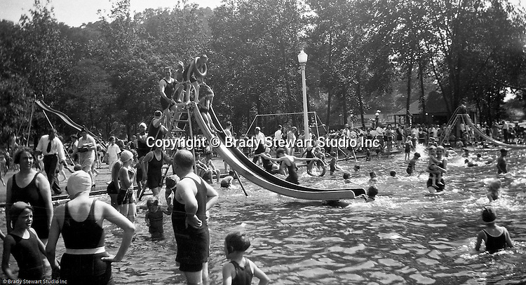 "South Park PA: Sally Stewart going down the slide at the South Park Swimming pool. The philosophy of recreation in the '20s and '30s was different than it is today. The differences between the haves and the have-nots of society were understood differently, and the county parks were called ""the people's country clubs,"" bringing to poorer people the same recreation that the wealthy paid for at private clubs: golf, tennis, swimming, picnicking. The parks offered common folk the chance to escape to rural campgrounds, day camps, and ""retreats."" Certain modern recreational concepts had not yet arrived: people didn't ""swim,"" they ""bathed""; hence, a large South Park pool was only four feet deep at its deepest point."