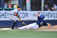 Rome Braves third baseman Kurt Hoekstra (16) fields the ball and tags out a hard sliding Vince Fernandez during a game against the Asheville Tourists at McCormick Field on July 29, 2017 in Asheville, North Carolina. The Braves defeated the Tourists 7-3. (Tony Farlow/Four Seam Images)