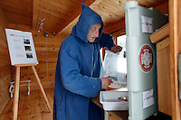 "Brother Cyril refilling the fridge that is the self serve shop with cheese,  outside the monestary...The new Munkeby Mariakloster - kloster is Norwegian for monastery . The four founding French monks will establish their discrete presence as a contemplative monastery according to the Rule of Saint Benedict, written in the 6th century. Brother Joel (55) & Cîteaux's Prior, brothers Arnaud (31), Bruno (33) and Cyril (81), have all chosen to be part of the founding community, despite Norway's rude climate and winter darkness at latitude 63º N, not far from the arctic circle.Munkeby, the ""place of the monks"" was the third and northernmost Norwegian monastery established by the Cistercians in the 12th century"