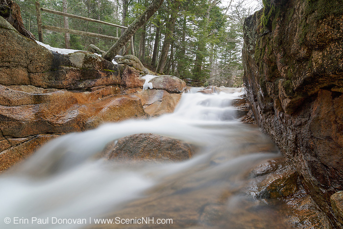 """Franconia Notch State Park - The Baby Flume, which is located just below """"The Basin"""" viewing area along the Pemigewasset River in Lincoln, New Hampshire USA during the spring months."""
