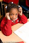 Parochial School Bronx New York  Kindergarten portrait of girl sitting at desk vertical