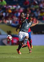Orlando, Florida - Saturday, June 04, 2016: Paraguayan forward Paulo Da Silva (14) makes a pass before Costa Rican midfielder Joel Campbell (12) can pressure during a Group A Copa America Centenario match between Costa Rica and Paraguay at Camping World Stadium.