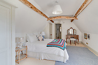 BNPS.co.uk (01202 558833)<br /> Pic: Mullucks/BNPS<br /> <br /> Pictured: Bedroom. <br /> <br /> Time for a change...<br /> <br /> A former granary with an impressive clock tower on top is on the market for £1.45m.<br /> <br /> The new owners of the aptly-named The Clockhouse will have a tall order adjusting this timepiece when the clocks go back at the end of October.<br /> <br /> The Grade II listed property has a 10ft central wooden clock tower which is believed to date back to the construction of the original granary building in the Georgian era.