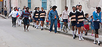 Cuba, Havana.  Young Women and School Children Walking.