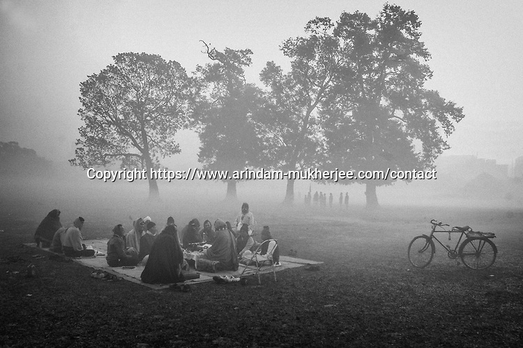 People gather at Midan (a huge green park in centre of Kolkata) to listen to religious chants by a priest in Kolkata, India.