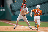 Houston Cougars first baseman Casey Grayson #18 lunges to make a catch while staying on the bag during the NCAA baseball game against the Texas Longhorns on March 1, 2014 during the Houston College Classic at Minute Maid Park in Houston, Texas. The Longhorns defeated the Cougars 3-2. (Andrew Woolley/Four Seam Images)