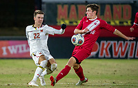 COLLEGE PARK, MD - NOVEMBER 15: Nick Richardson #22 of Maryland shoots past Joe Schmidt #16 of Indiana during a game between Indiana University and University of Maryland at Ludwig Field on November 15, 2019 in College Park, Maryland.