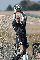 U.S. goalkeeper Tim Howard goes up high to gather in an Australian free kick near goal. The U.S. won the match, 3-1, played June 5th, in Ruimsig Stadium,  at Roodepoort, South Africa.