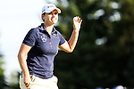 German's Caroline Masson waves to the crowd after making her putt on the eighteen hole during Round 4 at the LPGA Championship at Locust Hill Country Club in Pittsford, NY on June 9, 2013