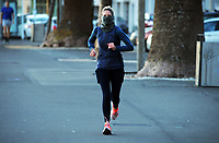 A masked runner on Oriental Parade at 7.30am, Friday during Level 4 lockdown for the COVID-19 pandemic in Wellington, New Zealand on Friday, 20 August 2021.